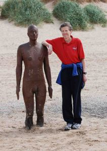 Lynn Pearson with a figure from Another Place by Antony Gormley in 2007